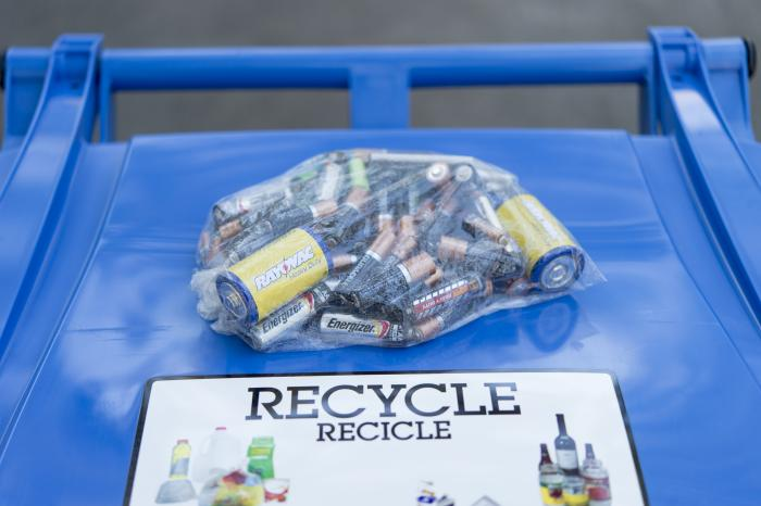 Batteries on top of recycling cart image